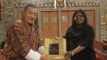 AIBD Interim Director presenting memento to Cabinet Secretary and Chair of BBS Board, Kezang Wangdi